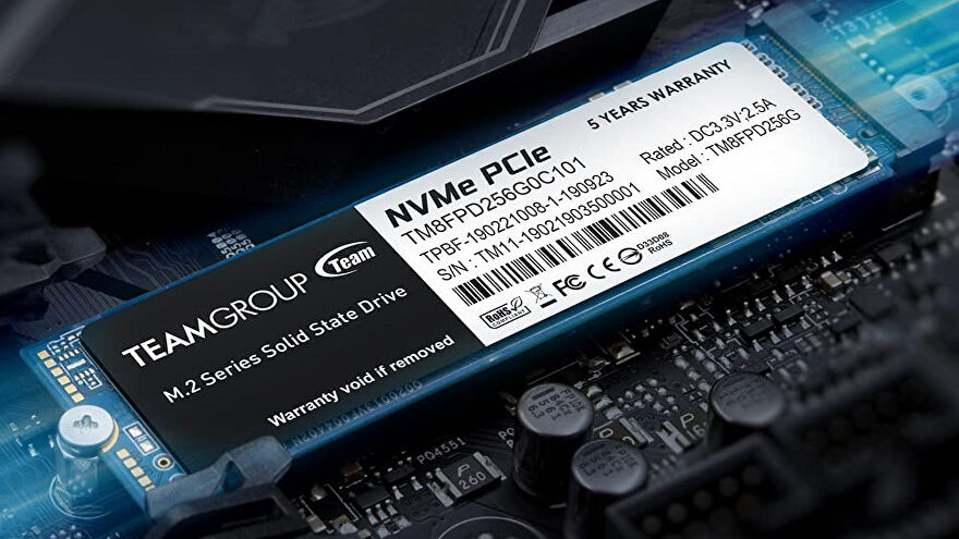 a photo of a teamgroup mp33 pro nvme ssd inserted into a motherboard; the words 'five years warranty' are highlighted.