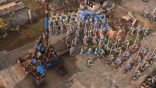 An army of horses surround a trebuchet in Age Of Empires 4