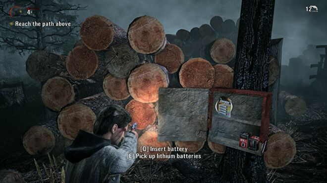 A screenshot of Alan Wake, showing some batteries and ammo in a container.
