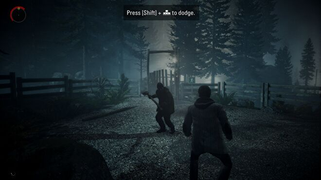 A screenshot of Alan Wake Remastered, showing Alan under attack from a shadowy axe-wielder.