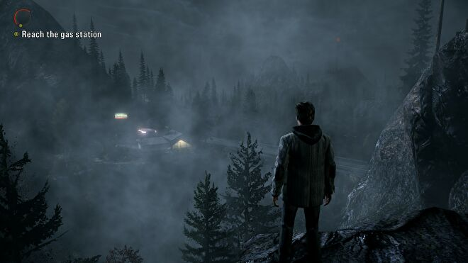 A screenshot of Alan Wake, showing Alan looking out across a forest ravine.