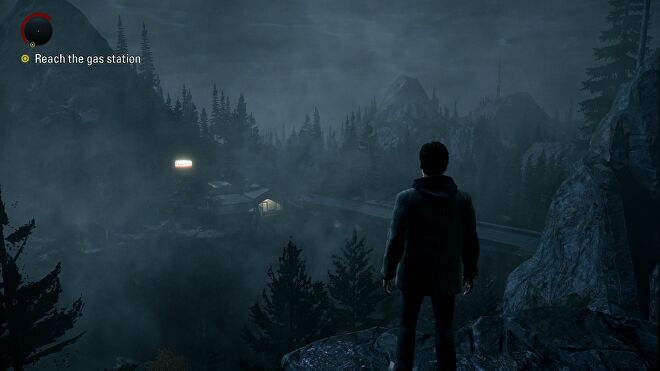 A screenshot of Alan Wake Remastered, showing Alan looking out across a forest ravine.