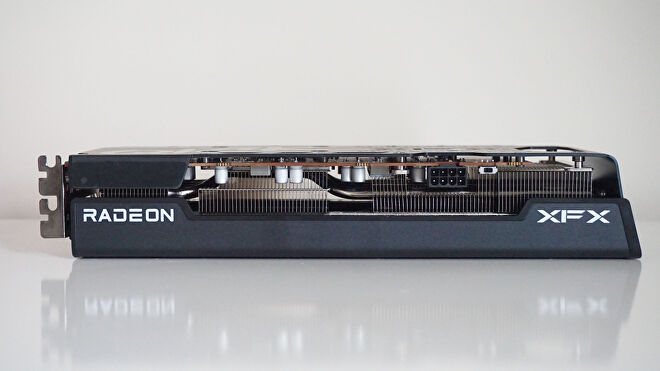 A photo of the AMD Radeon RX 6600 XT graphics card on its side, showing its single 8-pin power connector