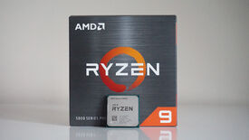 a photo of an amd ryzen 9 5900x 12-core processor in front of its box