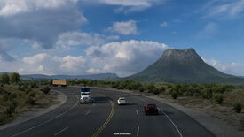 American Truck Simulator Texas - A four lane highway with cars and trucks passes through the plains with a large hill in the background.