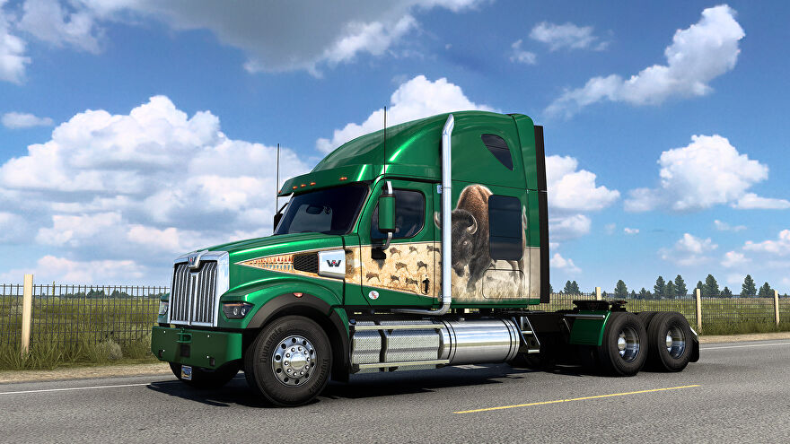 American Truck SImulator Wyoming DLC - An unloaded semi truck cab drives along an open road. The truck is green with a large bison painted on the side.