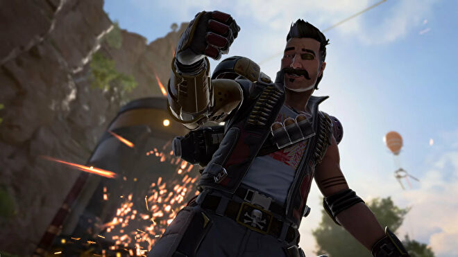 An Apex Legends screenshot of Fuse celebrating in front of explosives caused by his Knuckle Cluster Tactical ability.