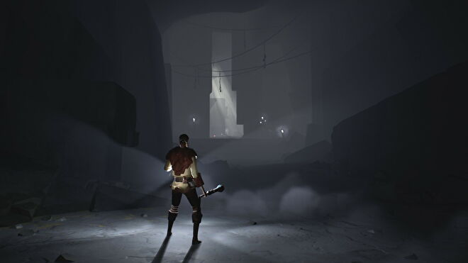 Someone holds a lamp to light their way in Ashen.