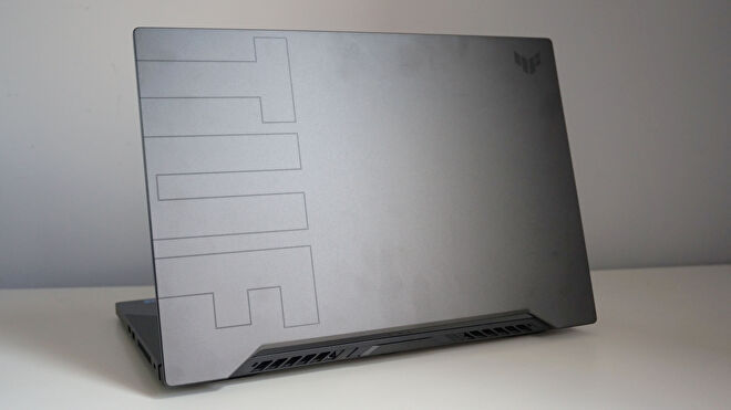 A photo of the Asus TUF Dash 15 gaming laptop's lid on a white desk