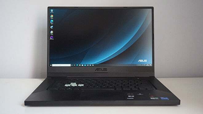 A photo of the Asus TUF Dash 15 gaming laptop on a white desk