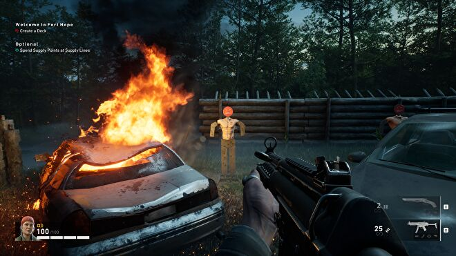 A target dummy next to a burning car in Back 4 Blood.