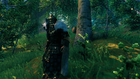 A Valheim screenshot of the player wearing full Padded Armor, standing in front of a forest.