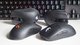 A photo of four wireless gaming mice in front of a keyboard