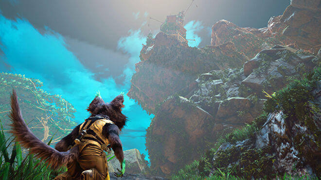 A Biomutant screenshot of the main character looking up at a tall structure atop a mountain.