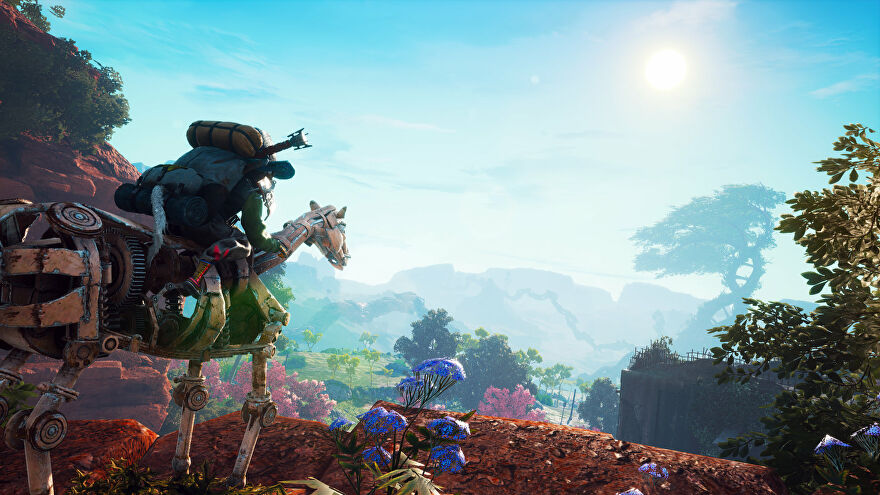 A Biomutant screenshot of the main character atop a mechanical steed on a cliff edge, looking down at the landscape below.