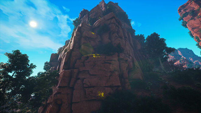 A Biomutant screenshot of a mountain with yellow paint on the side, indicating points you can use to quickly scale the mountain.