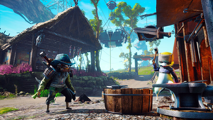 Biomutant - A player character cat in a blue, scaley cowboy hat and other assorted armor stands in a bright and colorful ramshackle town beside another cat character who wears a ushanka while hammering an anvil.