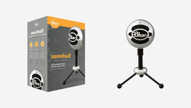 a photo of Blue's Snowball microphone, with a shiny spherical body suspended on three short little metal legs