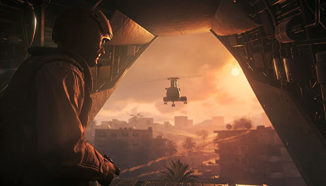 An image from Call Of Duty: Modern Warfare Remastered which shows a soldier riding in the back of a helicopter as the sun sets on the horizon.