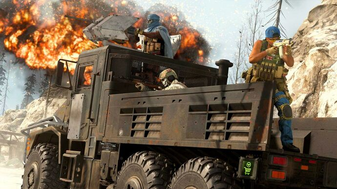 An image from Call Of Duty: Warzone which shows three players atop an armoured truck. One players mans a turret, and the two others are in the back looking down their rifles.