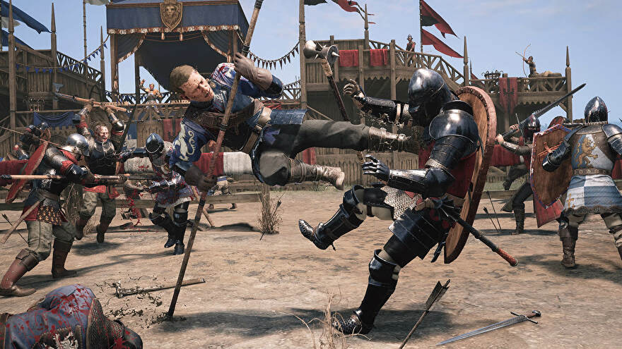 Civalry 2 - One combatant in blue leather armor uses the edge of their spear to vault into the air and kick another knight in the chest who's wearing plate armor and a helmet. Other combatants fight around them in the background in a dirt floor medieval tourney battleground.