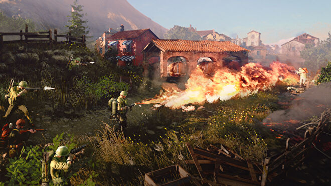 An army man with a flamethrower is burning some very nice rural houses in Company Of Heroes 3.