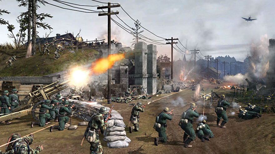 An urban battlefield with hundreds of soldiers running across the screen in Company Of Heroes 2