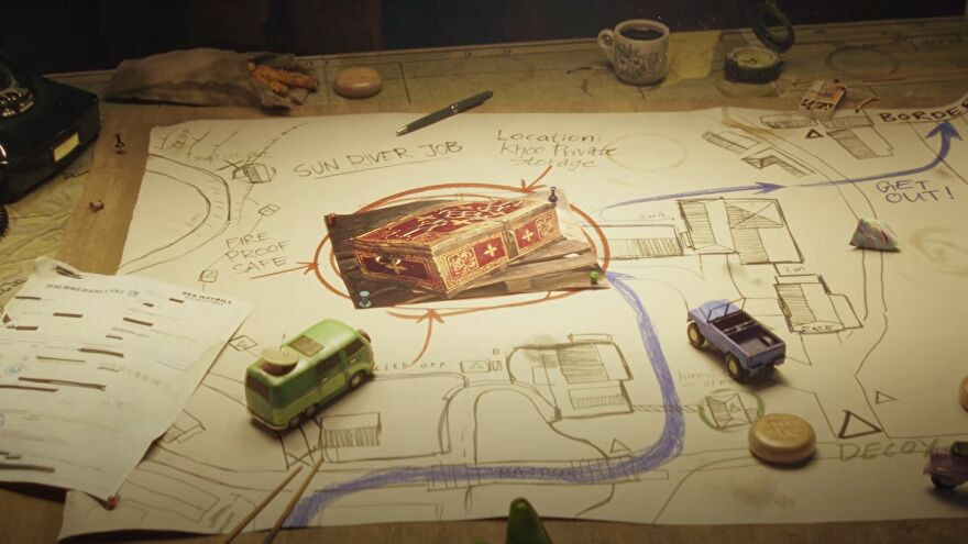 A map with a cool safe and loads of notes in the Contraband trailer.