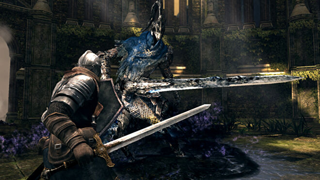 A knight readies their shield as they fight an even bigger knight in Dark Souls: Prepare To Die Edition