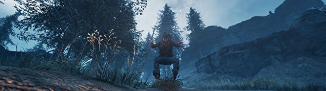 A screenshot of Deacon riding downhill on his motorcycle in Days Gone