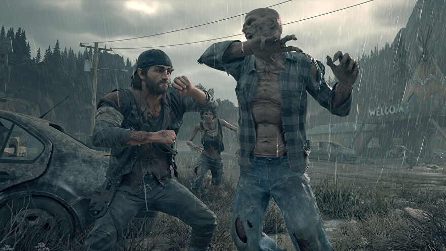 A screenshot of open world zombie drama Days Gone, showing a zombie taking a swing at a ducking protagonist.