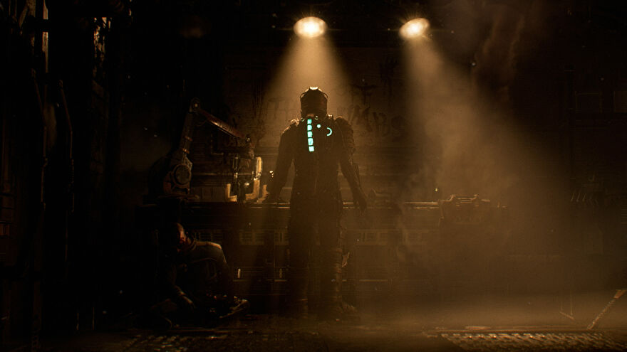 Isaac stands at a workbench in the Dead Space remake.