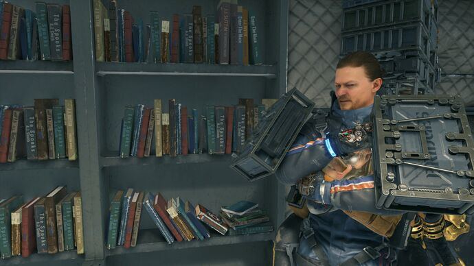 Image for I'm slowly becoming obsessed with video game book shelves