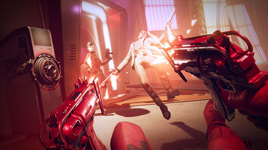 Colt dual-wielding pistols in Deathloop, shooting an enemy who has just entered the room.