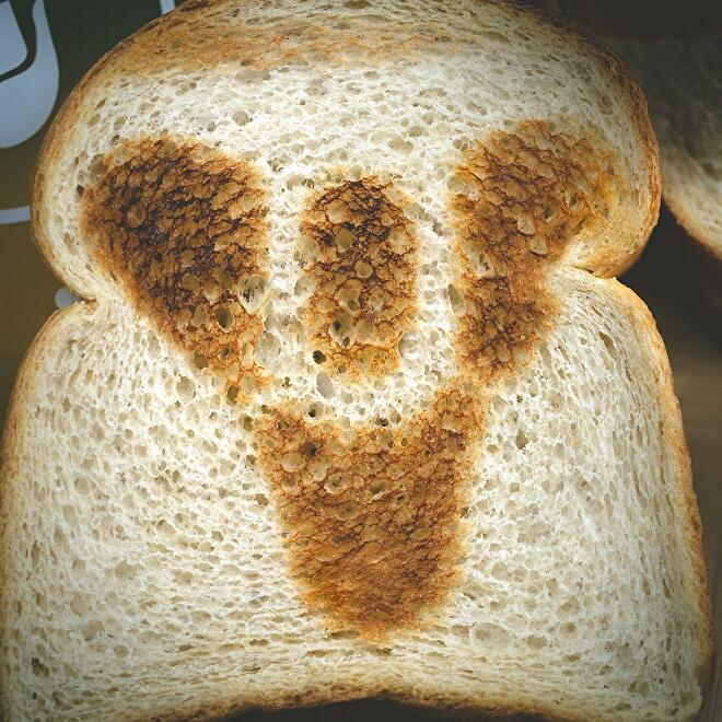 The Destiny logo toasted into bread by Destiny 2's long-awaited official toaster.