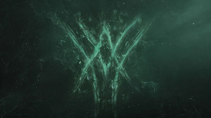 Destiny 2 - A teaser image for The Witch Queen expansion reveal. A flaming green logo made up of intersecting carats pointing up and down.