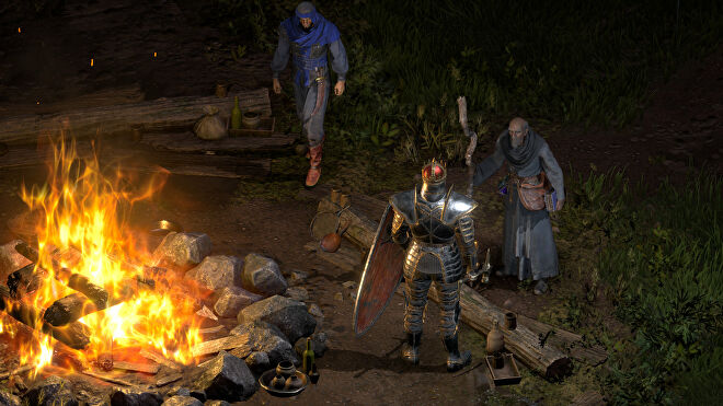 Staying awhile, and listening, with Deckard Cain by the campfire in a Diablo II: Resurrected screenshot.