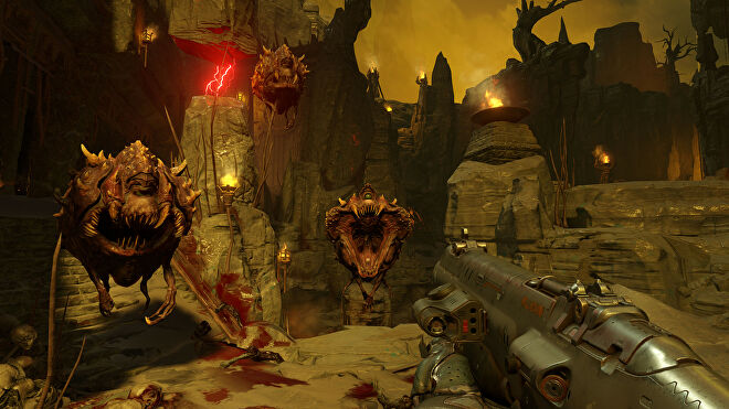 An image from Doom 2016 which shows the player aiming a shotgun at three floating horrors.
