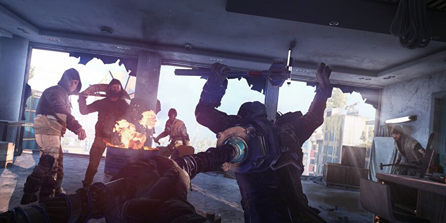 A screenshot of Dying Light 2 showing a man being struck by a big hammer while several other characters look on.
