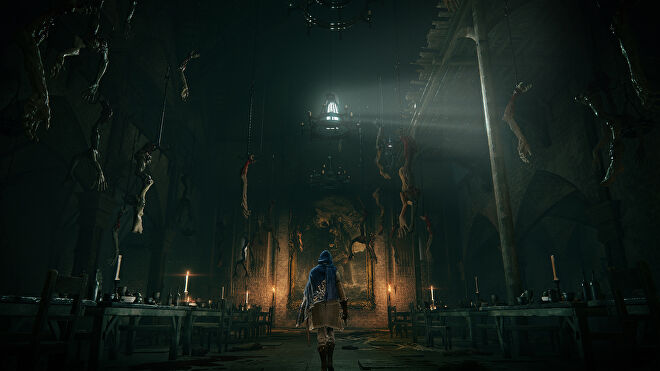 A figure walks down a dark hall with severed limbs hanging from ceiling hooks in an Elden Ring screenshot.