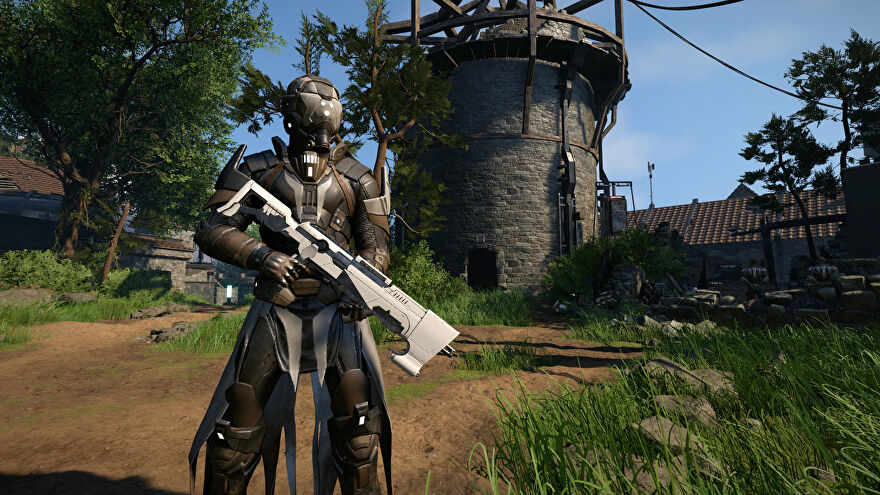 A person in high-tech armour stands before a crumbling stone tower in an Elex 2 screenshot.