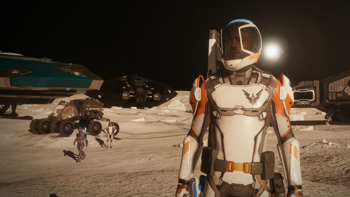 People standing on a moon in an Elite Dangerous: Odyssey screenshot.