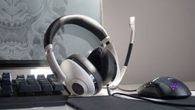 The EPOS H3 gaming headset on a desk next to a keyboard, mouse and monitor