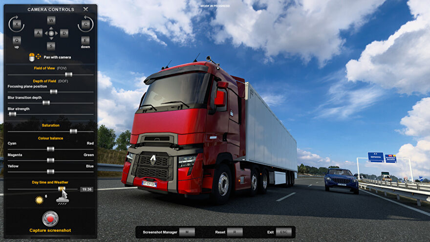 A screenshot of Euro Truck Simulator 2's revamped photo mode, showing a red truck gleaming under a blue sky on a motorway.