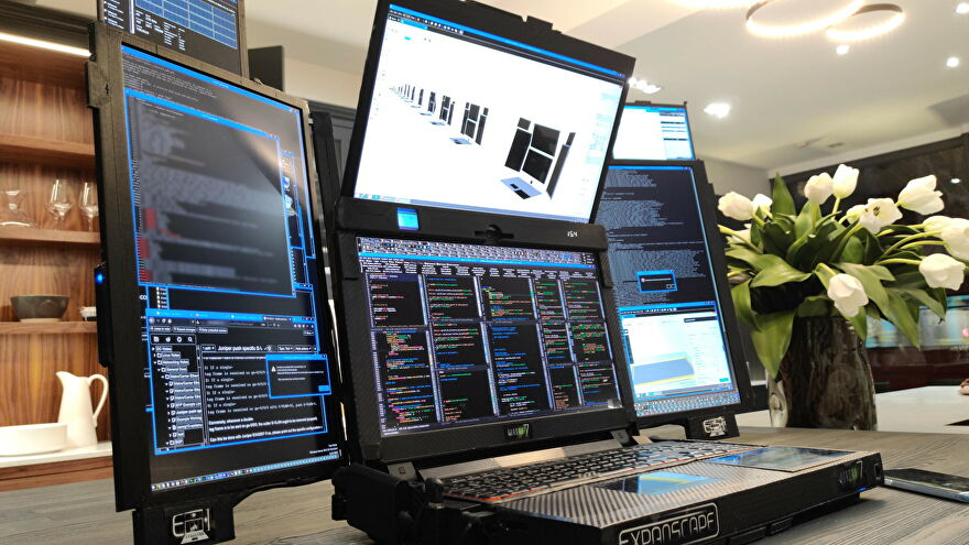 A photo of Expanscape's Aurora 7 laptop with seven screens folded out
