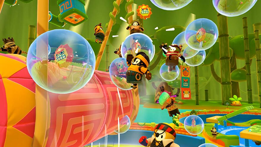 Fall Guys season 5 image - Several Fall Guys leap through the air towards bubbles with small lion head symbols in them.