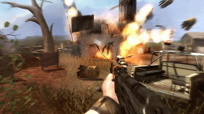 An image from Far Cry 2 which shows the player aiming an AK47 at a huge explosion.