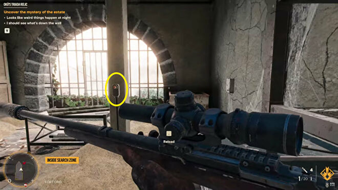 A Far Cry 6 screenshot of the player looking at the button which opens the well in the Oku's Triada Relic quest.