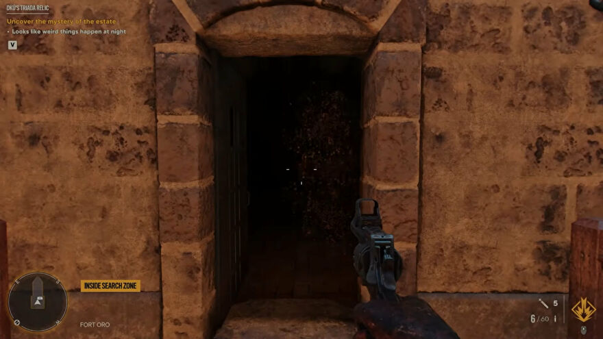 A screenshot of the open door to Fort Oro, home of Oku's Triada Relic in Far Cry 6.