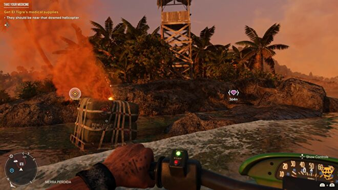 Dani pulls up beside a supply drop that's fallen by the coast in Far Cry 6.